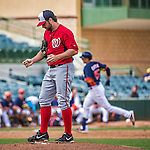 12 March 2014: Washington Nationals pitcher Tanner Roark stands on the mound after serving up a 2-run homer to Jason Castro who rounds rounds the bases in the 3rd inning of a Spring Training game against the Houston Astros at Osceola County Stadium in Kissimmee, Florida. The Astros rallied in the bottom of the 9th to edge out the Nationals 10-9 in Grapefruit League play. Mandatory Credit: Ed Wolfstein Photo *** RAW (NEF) Image File Available ***