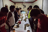 ARRIAGA, MEXICO - NOVEMBER 07: MIgrants pray before dinner at a migrant shelter a night before leaving Arriaga for the walk to Chahuites and further North on the 7th of November, 2015 in Arriaga, Mexico. <br /> Daniel Berehulak for The New York Times
