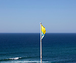 Plastic flag torn by wind of Atlantic Ocean, Odeceixe, Algarve, Portugal, Southern Europe