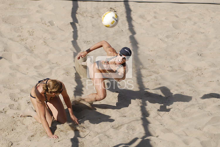 Huntington Beach, CA - 5/6/07:  Elaine Youngs, right, and Nicole Branagh try to get to the ball during Branagh / Youngs' 21-13, 21-13 loss to May-Treanor / Walsh in the championship match of the AVP Cuervo Gold Crown Huntington Beach Open of the 2007 AVP Crocs Tour..Photo by Carlos Delgado