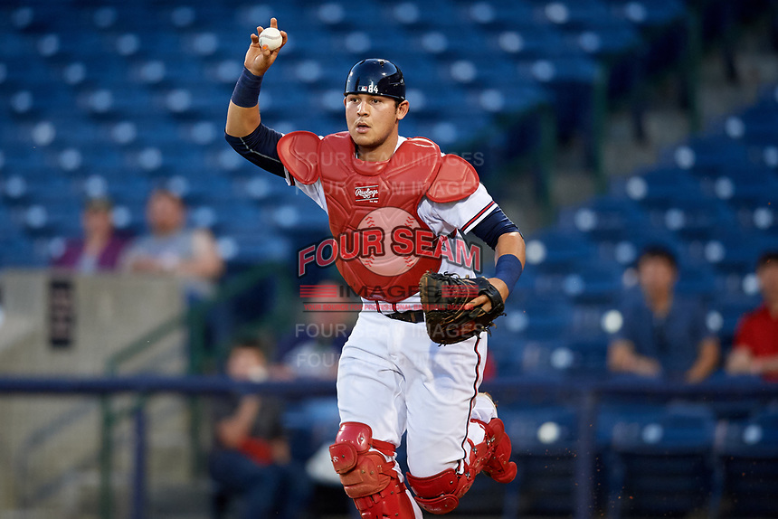 Mississippi Braves catcher Alex Jackson (25) chases a runner back to third base in a rundown during a game against the Mobile BayBears on May 7, 2018 at Trustmark park in Pearl, Mississippi.  Mobile defeated Mississippi 5-0.  (Mike Janes/Four Seam Images)