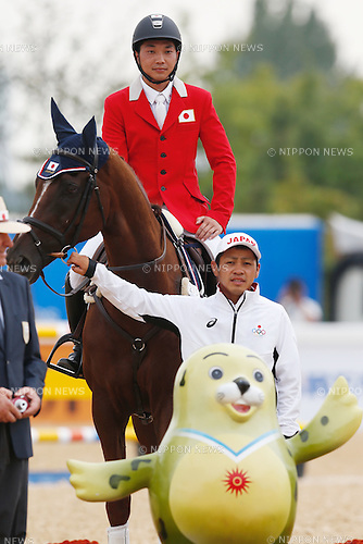 Toshiyuki Tanaka (JPN), <br /> SEPTEMBER 26, 2014 - Equestrian : <br /> Eventing Jumping Medal ceremony <br /> at Dream Park Equestrian Venue <br /> during the 2014 Incheon Asian Games in Incheon, South Korea. <br /> (Photo by AFLO SPORT)