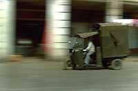 Three wheel vehicle being driven through the streets of Canton.Pictures taken in Canton China in 1977 at the time of the cultural revolution.
