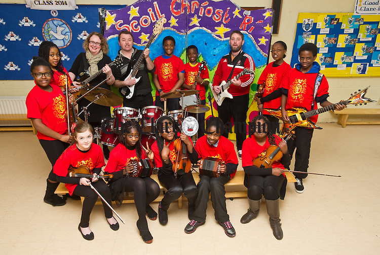 A group of Scoil Chriost Ri, Cloughleigh, Ennis, pupils who have bee short listed for the finals of the Comortas Amhran Naisunta at the National Pan Celtic finals in Carlow on Saturday night. Front from left;  Lauren Cusack, Zarena Boladale, Rebecca Sobamiwa, Emma Ikiebey and Deborah Babajide. Back from left; Glodia Luyinduladio, Chelsea Mba Ileozor, Karen Vaughan and Joe Garry, teachers, Abdul Saidi, Roy Jones Mbou, Paul Crehan, teacher, Axelle Hakizimana and Dereck Sholarin. Missing from photo are; Leah Fawl and Emmanuel Ikiebey. Photograph by John Kelly.