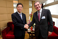 Vice Mayor of Shanghai Tu Guangshao (left), and GDF Suez CEO and Paris Europlace Chairman Gerard Mestrallet (right), at Shanghai / Paris Europlace Financial Forum, in Shanghai, China, on December 1, 2010. Photo by Lucas Schifres/Pictobank