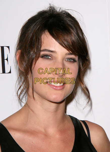 "COBIE SMULDERS .attends the ELLE and Express ""25 at 25"" Event held at The Palihouse Holloway in West Hollywood, California, USA,  October 7th 2010..portrait headshot black fringe .CAP/RKE/DVS.©DVS/RockinExposures/Capital Pictures."