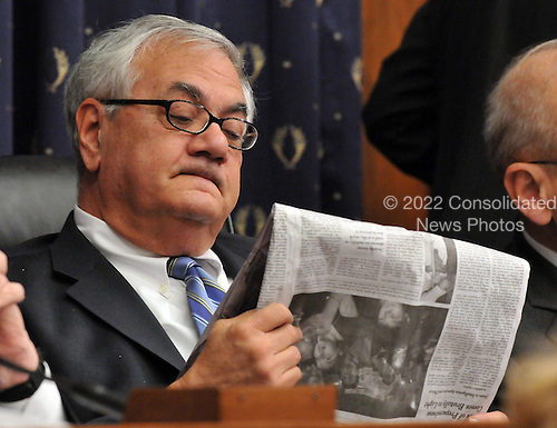 "Washington, DC - December 5, 2008 -- United States Representative Barney Frank (Democrat of Massachusetts), Chairman, United States House Financial Services Committee, reads an article in the New York Times as he listens to testimony during the hearing ""On review of industry plans to stabilize the financial condition of the American automobile industry"" in Washington, D.C. on Friday, December 5, 2008..Credit: Ron Sachs / CNP"