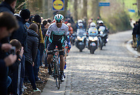 Kristian House (GBR/ONE) leading the race up the Taaienberg<br /> <br /> 71st Omloop Het Nieuwsblad 2016
