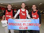 Brian Guilfoyle, Des Feeley and David Gough of Drogheda and District  Athletic club who are training to run the Dublin city marathon pictured collecting funds for the Special Olympics at the Laurence Centre. Photo: Colin Bell/pressphotos.ie