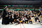 09 APR 2011: The University of Minnesota Duluth Bulldogs pose as a team while accepting the championship trophy during the Division I Men's Ice Hockey Championship held at the Xcel Energy Center in St. Paul, MN. Minnesota-Duluth beat Michigan in overtime, 3-2 to claim the national title. Vince Muzik/ NCAA Photos
