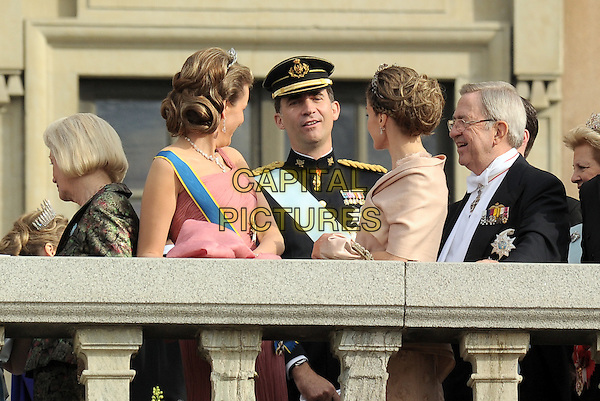 CROWN PRINCESS  MATHILDE OF BELGIUM, CROWN PRINCE FELIPE OF SPAIN, CROWN PRINCESS LETIZIA OF SPAIN.Wedding Of Swedish Crown Princess Victoria and Daniel Westling, Princess Couple at Lejonbacken Terrace at the Royal Palace, Stockholm, Sweden,.19th June 2010.half length crown tiara sash pink one shoulder dress  beige hat uniform side .CAP/RD .©Richard Dean/Capital Pictures