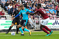 Fleetwood Town's Wes Burns competing with Northampton Town's Aaron Pierre <br /> <br /> Photographer Andrew Kearns/CameraSport<br /> <br /> The EFL Sky Bet League One - Northampton Town v Fleetwood Town - Saturday August 12th 2017 - Sixfields Stadium - Northampton<br /> <br /> World Copyright &copy; 2017 CameraSport. All rights reserved. 43 Linden Ave. Countesthorpe. Leicester. England. LE8 5PG - Tel: +44 (0) 116 277 4147 - admin@camerasport.com - www.camerasport.com