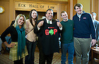 "November 18, 2011; New Jersey Gov. Chris Christie poses for a photo with students as he holds up a T-shirt they gave him during a meet-and-greet in the Eck Commons. Christie delivered the keynote address during a daylong symposium, titled ""Educational Innovation and the Law"" in the Patrick F. McCartan Courtroom at the Notre Dame Law School. Photo by Barbara Johnston/University of Notre Dame."