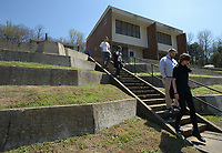 NWA Democrat-Gazette/ANDY SHUPE<br /> Members of the Fayetteville Housing Authority Board of Directors and members of the public walk down a flight of stairs Friday, March 30, 2018, during a tour of Willow Heights in Fayetteville. The board this year has to come up with a capital improvements plan, per U.S. Department of Housing and Urban Development regulations.