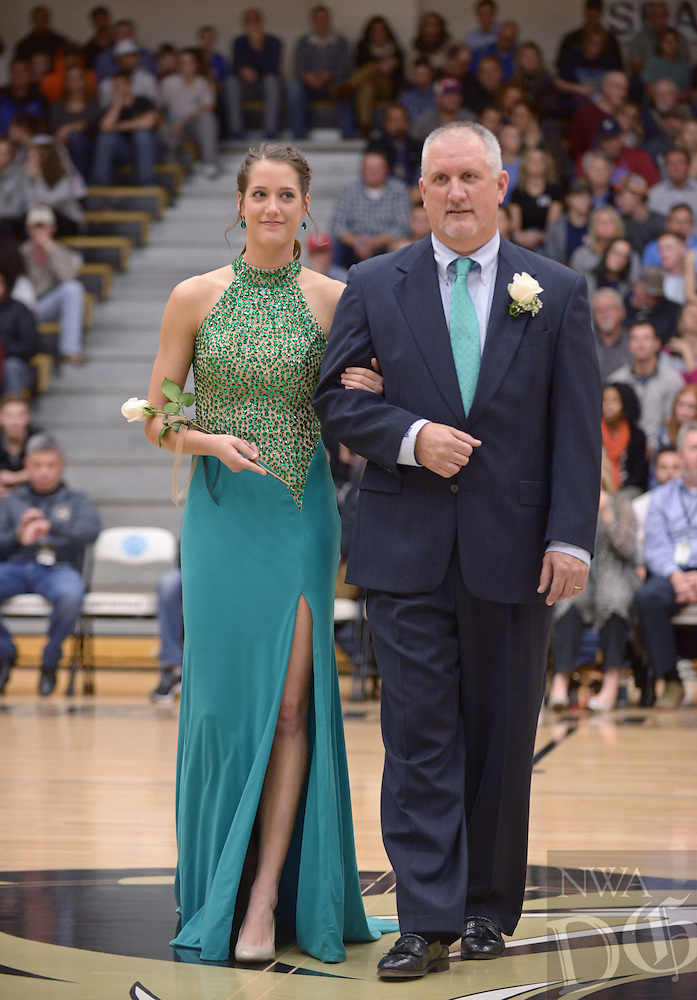 NWA Democrat-Gazette/BEN GOFF @NWABENGOFF<br /> Madison Brittain and father Mark Brittain take the floor on Friday Jan. 15, 2016 during Bentonville High's colors day ceremony at halftime in the boys basketball game against Springdale Har-Ber in Bentonville's Tiger Arena.