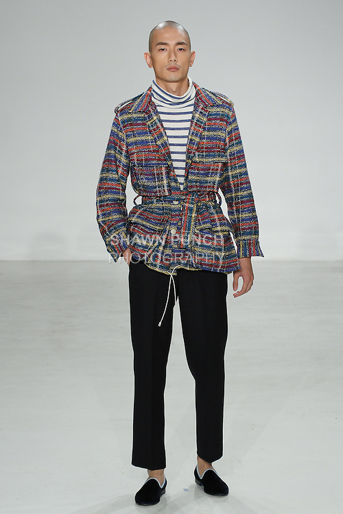 Model walks runway in a bright plaid safari jacket, blue stripe turtleneck and navy como trouser, from the Palmiers du Mal Spring Summer 2017 collection by Brandon Capps and Shane Fonner, at Skylight Clarkson Square on July 14 2016, during New York Fashion Week Men's Spring Summer 2017.