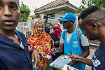 28 August 2019, Jakarta, Indonesia: - African refugees from Somalia and Ethiopia checking off their names outside the UNHCR refugee centre in Kalideres, Jakarta. Plans to re-locate the overcrowded refugees have been fast tracked after a fight broke out between the groups, many of whom have been in Indonesia for years waiting for placement. Tensions ran high between Afghan and African groups in the centre with a lack of adequate food for the refugees being the catalyst. The African groups, who were moved onto the footpath, were being bussed out today. Conditions in the centre are grim and the local Indonesian population not happy with the refugees presence in the suburb.Picture by Graham Crouch/The Australian