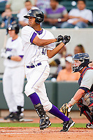Jose Martinez #40 of the Winston-Salem Dash follows through on his swing against the Kinston Indians at BB&T Ballpark on June 4, 2011 in Winston-Salem, North Carolina.   Photo by Brian Westerholt / Four Seam Images