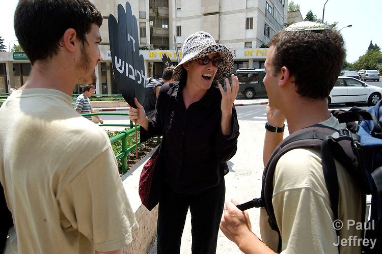 """One of Israel's """"Women in Black"""" discusses with passersby during the women's their weekly peace vigil at a busy Jerusalem street corner. The women oppose Israel's occupation of Palestinian territories."""