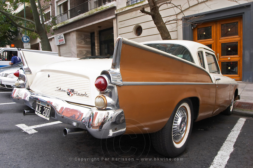 A Studebaker Silver Hawk Classic Car parked on a street, painted in cream white and brown, ca 1950s 50s, detail of read back tail lights taillights and tail wings 1950 50 Buenos Aires Argentina, South America