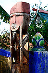 A wooden spirit guardian stands watch over a grave in a Jarai cemetery in the Central Highlands near Kon Tum, Vietnam. The Jarai are the largest of more than two dozen Montagnard, or Dega, hill tribes. They believe the spirits of the deceased linger for a long time, often years, after death, and relatives bring food and drink to appease the spirits before they pass on to the next world.  After the spirit has been determined to have passed on, the grave is abandoned, and a carved wooden statue is erected to watch over it. April 14, 2012.