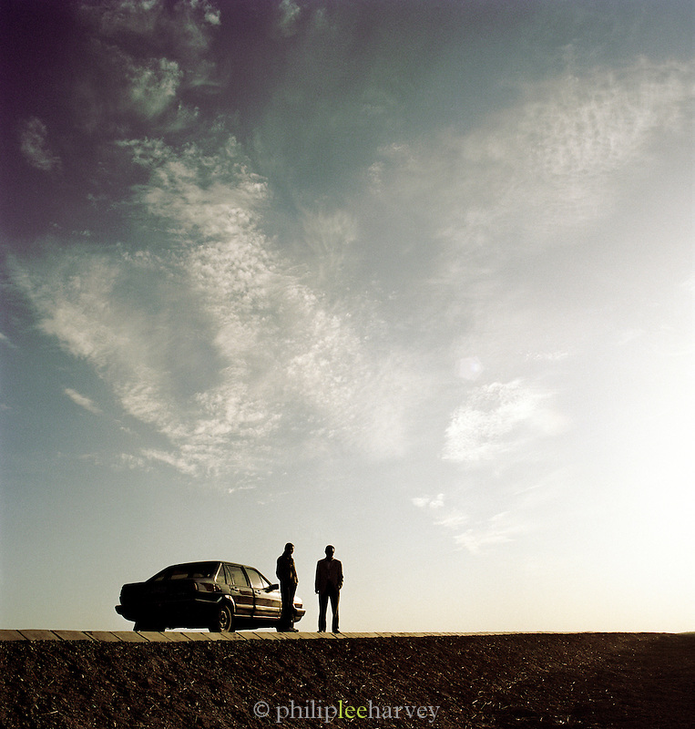 Tourists guides on road to Jiayuguan, Silk Route, Dunhuang, Jiuquan, Gansu Province, China.