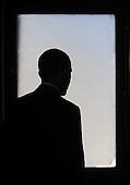 "The silhouette of United States President Barack Obama as he tours a ""trophy"" office building at 815 Connecticut Avenue, NW, and later speaks about job creation and energy efficiency Friday, December 2, 2011 in Washington, DC.  Obama has recruited former U.S. President Bill Clinton (not pictured) and major corporations including 3M Co. and Alcoa Inc. in a $4 billion initiative to cut energy costs in buildings and encourage hiring for construction jobs.  To date, the energy efficiency measures in this building that have been completed are saving almost $200,000 per year, or over $0.99 per square foot. .Credit: Olivier Douliery / Pool via CNP"