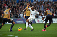 Andre Ayew of Swansea attemptes to get through the Arsenal defence during the Barclays Premier League match between Swansea City and Arsenal at the Liberty Stadium, Swansea on October 31st 2015