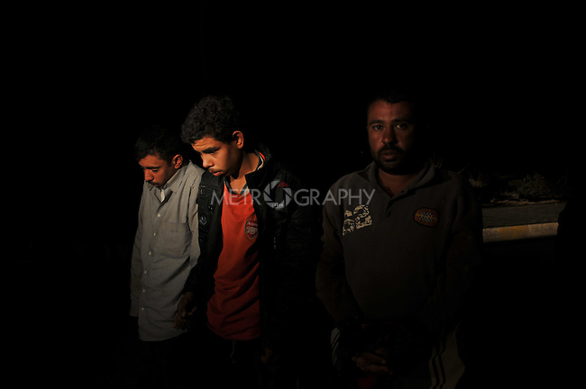 KIRKUK, IRAQ: Three Iraqi men are arrested under suspicion of being terrorists during an anti-terror raid...After receiving intelligence about a terrorist training camp in the Hamria mountains, the Kirkuk Regional Police conduct a dawn raid...This is the first anti-terror raid in Kirkuk after the withdrawal of US troops..Photo by Pazhar Mohammad/Metrography