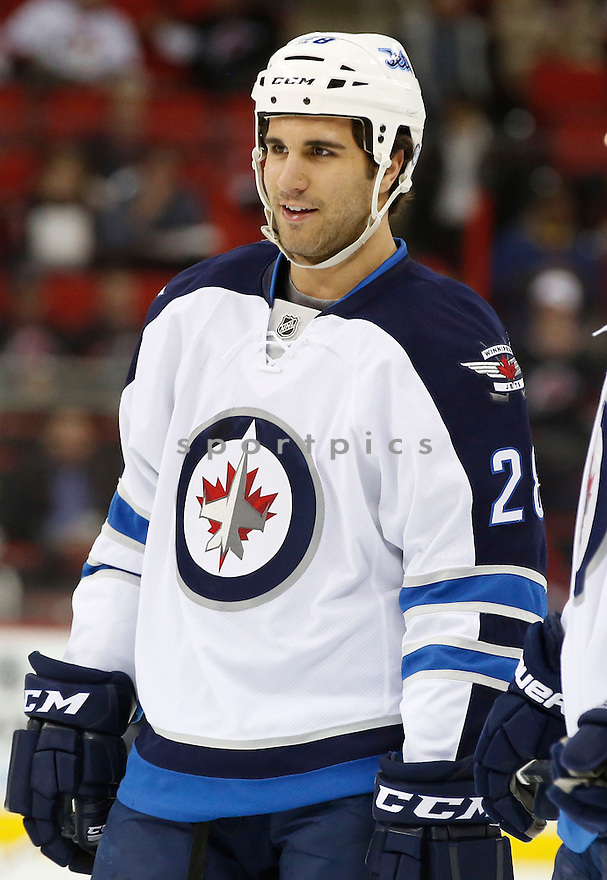 Winnipeg Jets Patrice Corimer (28) during a game against the Carolina Hurricanes on March 26, 2013 at PNC Arena in Charlotte, NC. The Jets beat the Hurricanes 3-1.