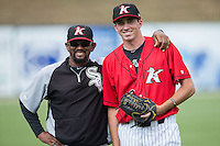 Kannapolis Intimidators pitching coach Jose Bautista (38) poses for a photo with starting pitcher Zach Thompson (40) prior to the game against the Delmarva Shorebirds at CMC-Northeast Stadium on June 7, 2015 in Kannapolis, North Carolina.  The Shorebirds defeated the Intimidators 9-1.  (Brian Westerholt/Four Seam Images)