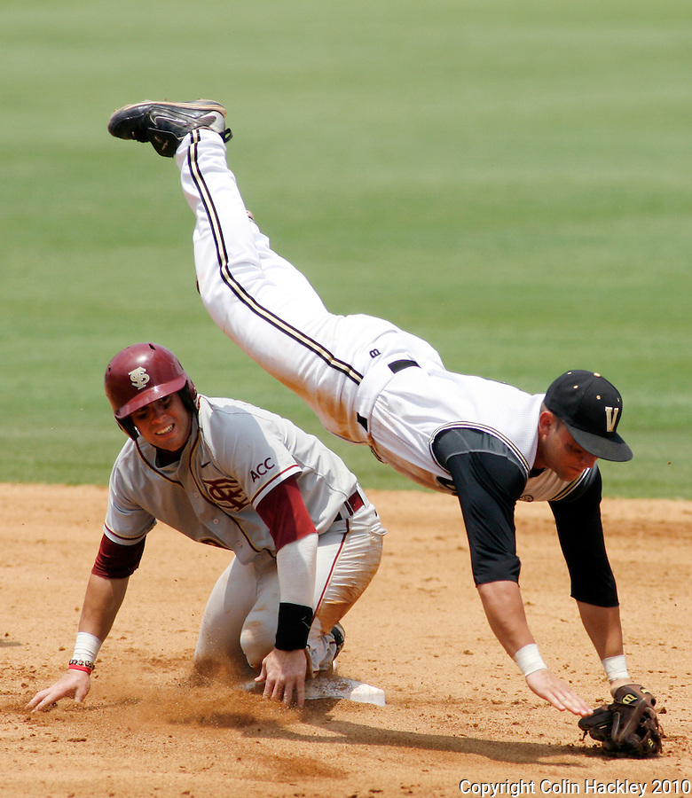 TALLAHASSEE, FL 6/12/10-FSU-VANDY BASE10 CH-Florida State's Stephen Cardullo up ends Vanderbilt's Brian Harris after being forced out during a fourth inning double play Saturday during NCAA Super Regional action at Dick Howser Stadium in Tallahassee. The Commodores beat the Seminoles 6-2 to stay alive for game three...COLIN HACKLEY PHOTO