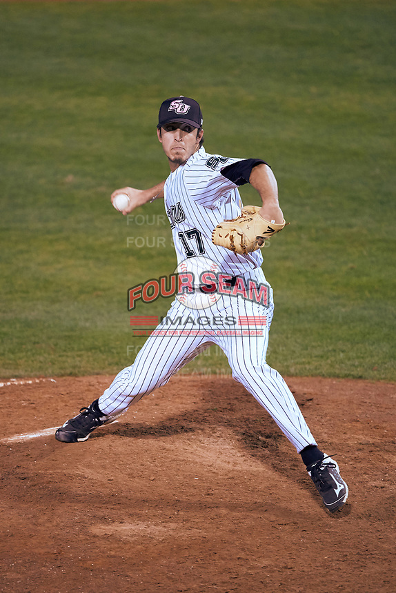 Stetson Hatters relief pitcher Joey Gonzalez (17) delivers a pitch during a game against the Siena Saints on February 23, 2016 at Melching Field at Conrad Park in DeLand, Florida.  Stetson defeated Siena 5-3.  (Mike Janes/Four Seam Images)