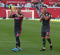 Leeds United's Ezgjan Alioski and Jack Harrison applauds the fans at the final whistle <br /> <br /> Photographer Stephen White/CameraSport<br /> <br /> The Premier League - Stoke City v Leeds United - Saturday August 24th 2019 - bet365 Stadium - Stoke-on-Trent<br /> <br /> World Copyright © 2019 CameraSport. All rights reserved. 43 Linden Ave. Countesthorpe. Leicester. England. LE8 5PG - Tel: +44 (0) 116 277 4147 - admin@camerasport.com - www.camerasport.com