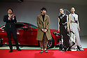 """March 14, 2016, Tokyo, Japan - Mercedes Benz Japan president Kintaro Ueno (L) and Japanese designer Yu Amatsu of """"Hanae Mori manuscrit"""" with models stand next to Mercedes-Benz new C-class coupe at Mercedes' showroom in Tokyo on Monday, March 14, 2016 as Mercedes introduces the new coupe model on Japanese market. Tokyo fashion week sponsored by Merceds Benz started here on March 14 and runs through to the 19th.  (Photo by Yoshio Tsunoda/AFLO) LWX -ytd-"""
