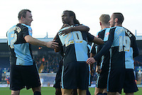 Wycombe Wanderers Luke O'Nien celebrates with team mates after putting the visitors 1-0 ahead during the Sky Bet League 2 match between Mansfield Town and Wycombe Wanderers at the One Call Stadium, Mansfield, England on 31 October 2015. Photo by Garry Griffiths.
