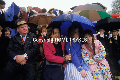 Eton college school, near nr Windsor Berkshire. England<br /> <br /> A rainy afternoon, on Fellow&rsquo;s Eyot, parents and siblings assemble to watch the procession of boats.