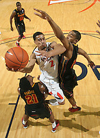 Jan. 27, 2011; Charlottesville, VA, USA; Virginia Cavaliers guard Mustapha Farrakhan (2) shoots between Maryland Terrapins guard Pe'Shon Howard (21) and Maryland Terrapins guard/forward Cliff Tucker (24) during the game at the John Paul Jones Arena. Maryland won 66-42. Mandatory Credit: Andrew Shurtleff