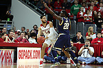 25 January 2015: NC State's Caleb Martin (14) and Notre Dame's Jerian Grant (22). The North Carolina State University Wolfpack played the University of Notre Dame Fighting Irish in an NCAA Division I Men's basketball game at the PNC Arena in Raleigh, North Carolina. Notre Dame won the game 81-78 in overtime.