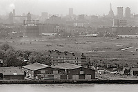 Looking across derelict land that was once the Surrey Commercial Docks, towards the City from the isle of Dogs.