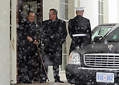 Former United States President George H.W. Bush (L) and his son former Florida Governor Jeb Bush (C) depart the West Wing of the White House after meeting with U.S. President Barack Obama in Washington, D.C. on January 30, 2010. .Credit: Alexis C. Glenn / Pool via CNP