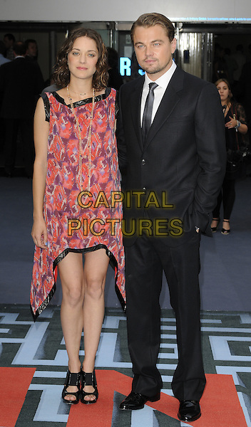 MARION COTILLARD & LEONARDO DICAPRIO .At the World Premiere of 'Inception' at the Odeon Leicester Square cinema, Leicester Square, London, England, .UK, July 8th 2010..arrivals full length red print dress scarf sleeveless black trim purple patterned pattern open toe sandals asymmetric suit tie white shirt hand in pocket leo di caprio .CAP/CAN.©Can Nguyen/Capital Pictures.