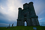 A couple approaches Paxton's Tower in Wales, the United Kingdom. Paxton's Tower is a castle like building belonging to the Landmark Trust, a United Kingdom building preservation charity that rescues historic buildings at risk and gives them a new life as places to stay in and experience.