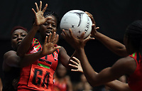 23.02.2018 Jamaica's Vangelee Williams and Malawi's Sindi Simtowe in action during the Malawi v Jamaica Taini Jamison Trophy netball match at the North Shore Events Centre in Auckland. Mandatory Photo Credit ©Michael Bradley.