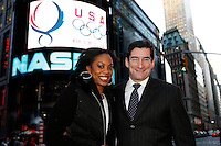 Sanya Richards (Left) poses with Robert Greifeld(Right) President, CEO of NASDAQ at NASDAQ Market site 4 Broadway, NYC on Wednesday, January 2, 2008. Photo by Errol Anderson.