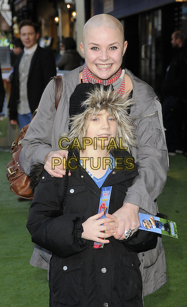 GAIL PORTER & HONEY HIPGRAVE .Attending the 'Gnomeo And Juliet' UK film premiere, Odeon cinema, Leicester Square, London, England, UK,.30th January 2011..& arrivals half length grey gray coat red striped scarf black daughter mother family mom mum fur hood .CAP/CAN.©Can Nguyen/Capital Pictures.