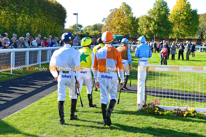 Jockeys enter the Parade Ring during Afternoon Racing at Salisbury Racecourse on 3rd October 2018