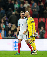 Jordan Henderson (Liverpool) of England chats with Pepe Reina of Spain after the match during the International Friendly match between England and Spain at Wembley Stadium, London, England on 15 November 2016. Photo by Andy Rowland.