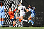 07 September 2012: UNC's Paige Nielsen (24) scores the game's first goal past Marquete's Sofie Schunk (1) and Emily Jacobson (19). The University of North Carolina Tar Heels defeated the Marquette University Golden Eagles 4-0 at Koskinen Stadium in Durham, North Carolina in a 2012 NCAA Division I Women's Soccer game.