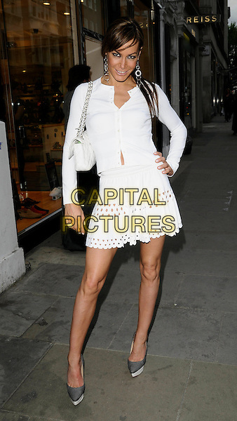 TARA PALMER TOMKINSON.Attending the launch of German make-up brand Artdeco at The Garden Pharmacy, London, England, UK,.May 6th 2009..TPT full length white cardigan skirt eyelet cut out Chanel bag quilted chain shoulder strap designer grey gray pointy shoes heels platforms hand on hip ring .CAP/CAN.©Can Nguyen/Capital Pictures